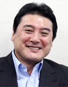 須古 勝志氏 photo