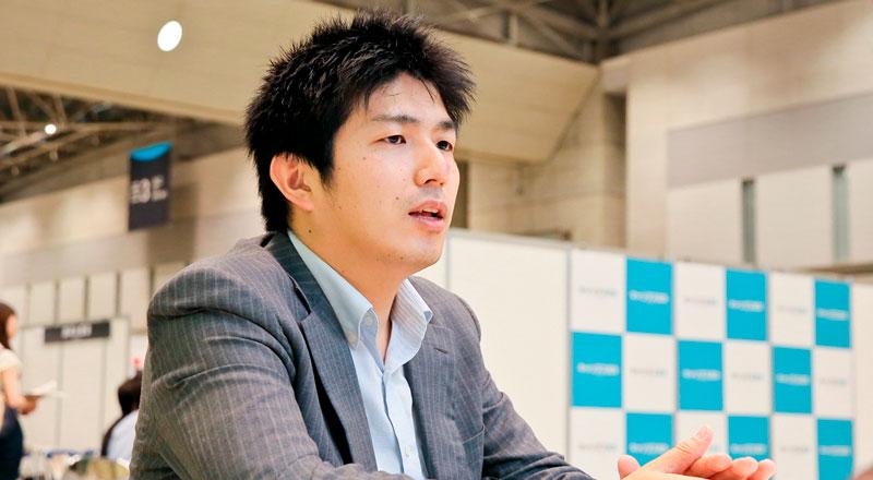 日清食品ホールディングス株式会社 土居仁さん Photo